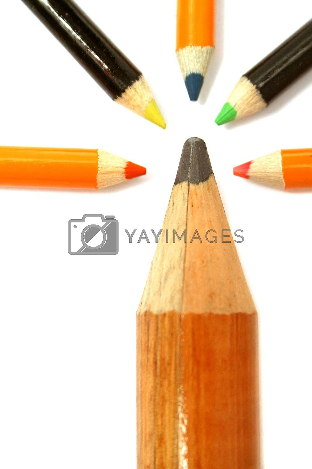 The big pencil and five small color pencils on a vertical 4