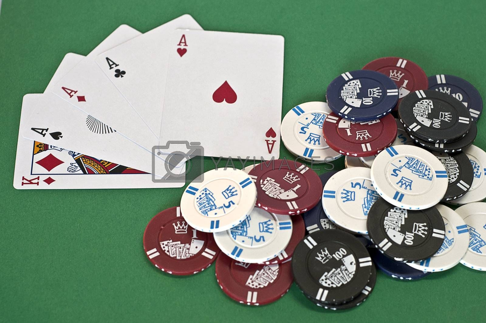 poker chips with axes of different cuts and colors on green background