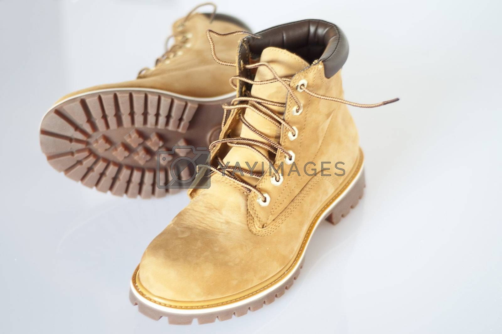 a pair of men\u0026#39;s leather boots with rubber soles