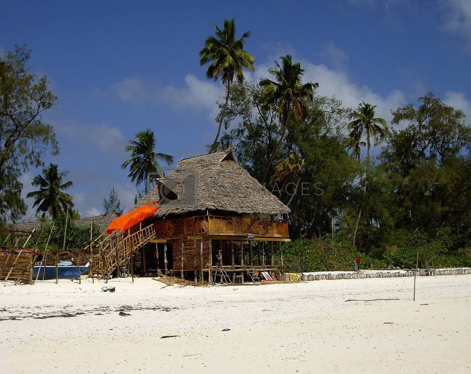 typical restaurant on the beach with Zanzibari roof of palm fronds
