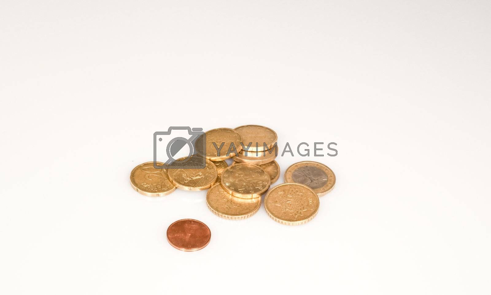 coins of different values on a white background