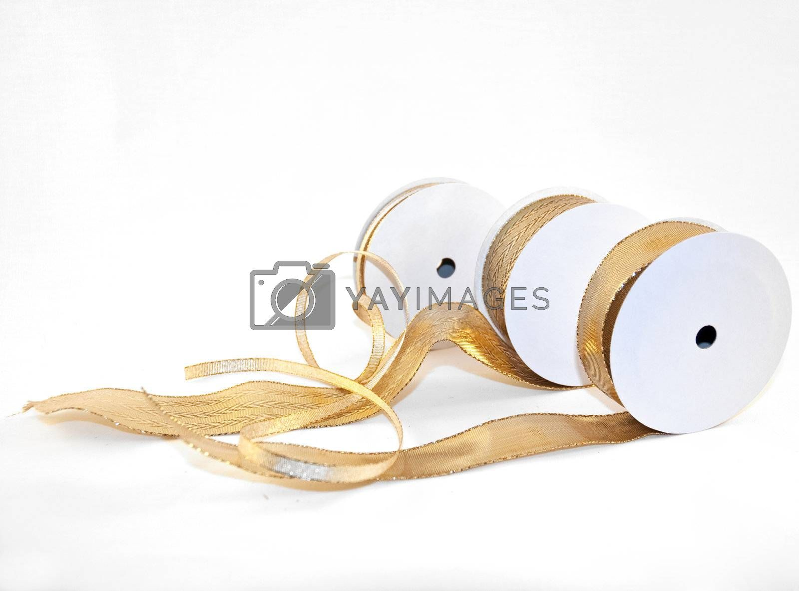 three different types of gold ribbons on white background