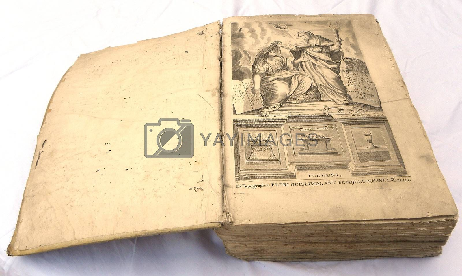 very old bible open on a white background