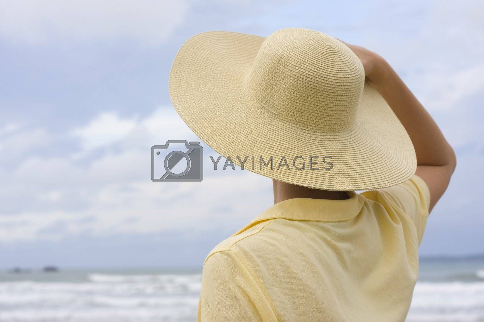 Royalty free image of Woman with hat on a beach by ArtmannWitte