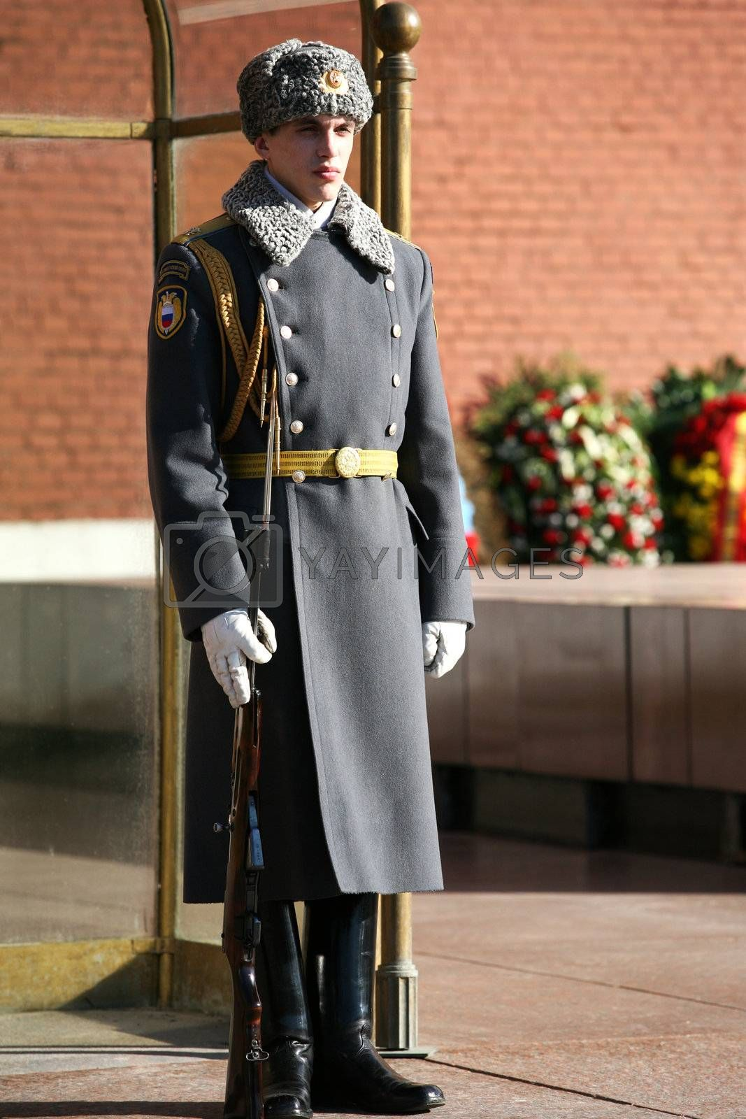 Russian soldier with the weapon, standing at attention