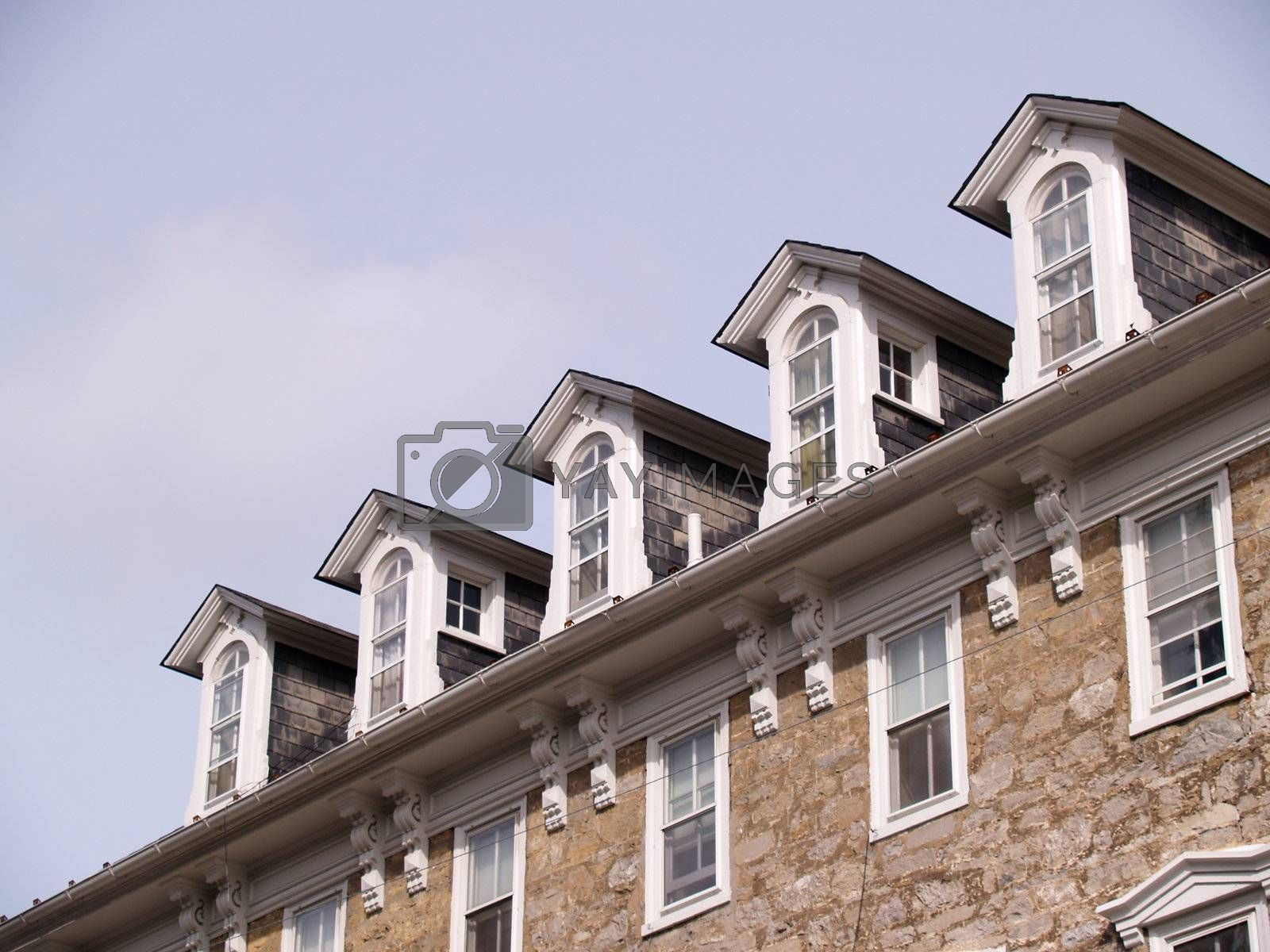 rooftop windows for an old stone building