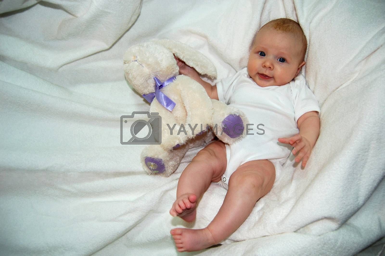 Lovely baby with  blue eyes, palming bunny - toy