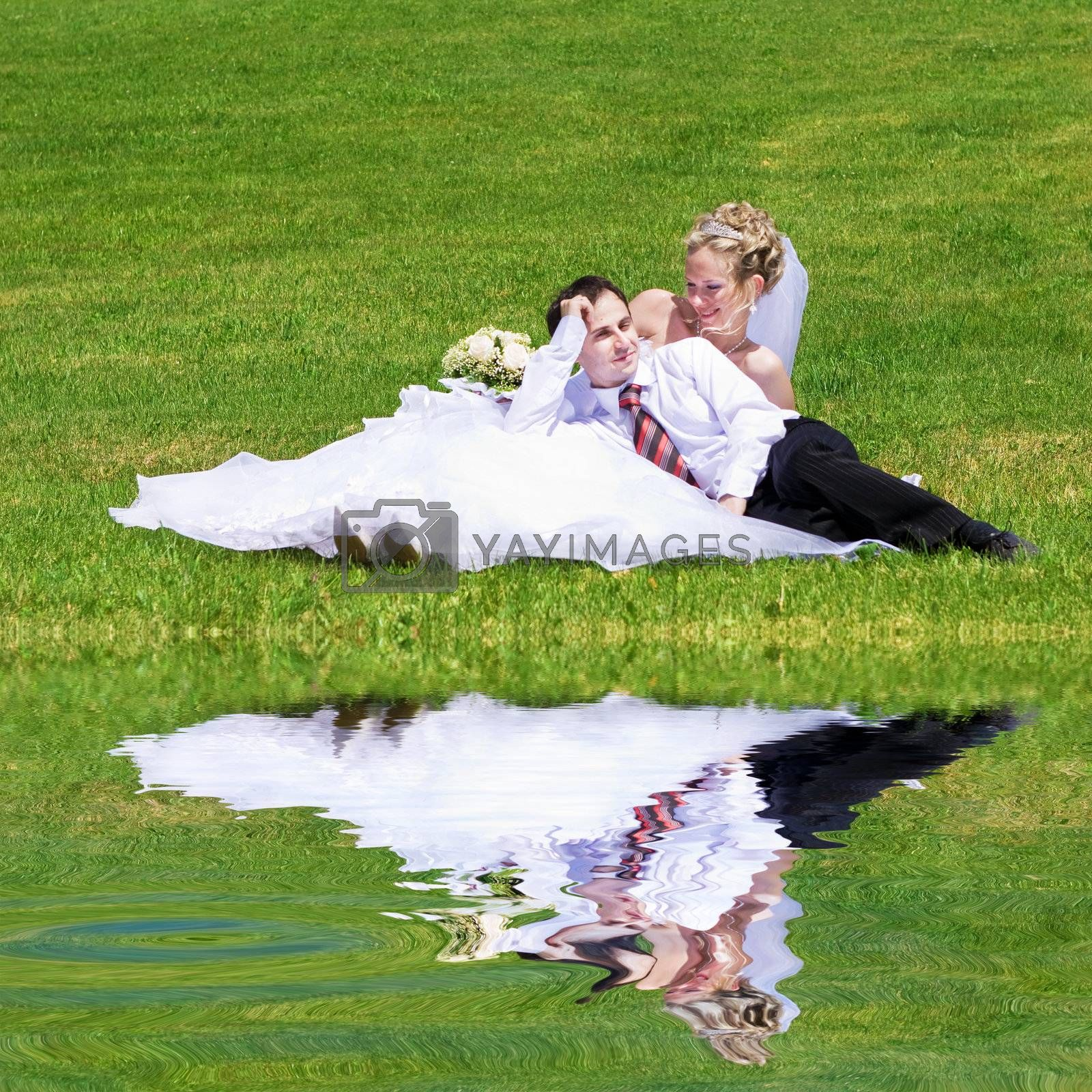 rest of newly married couple near the lake