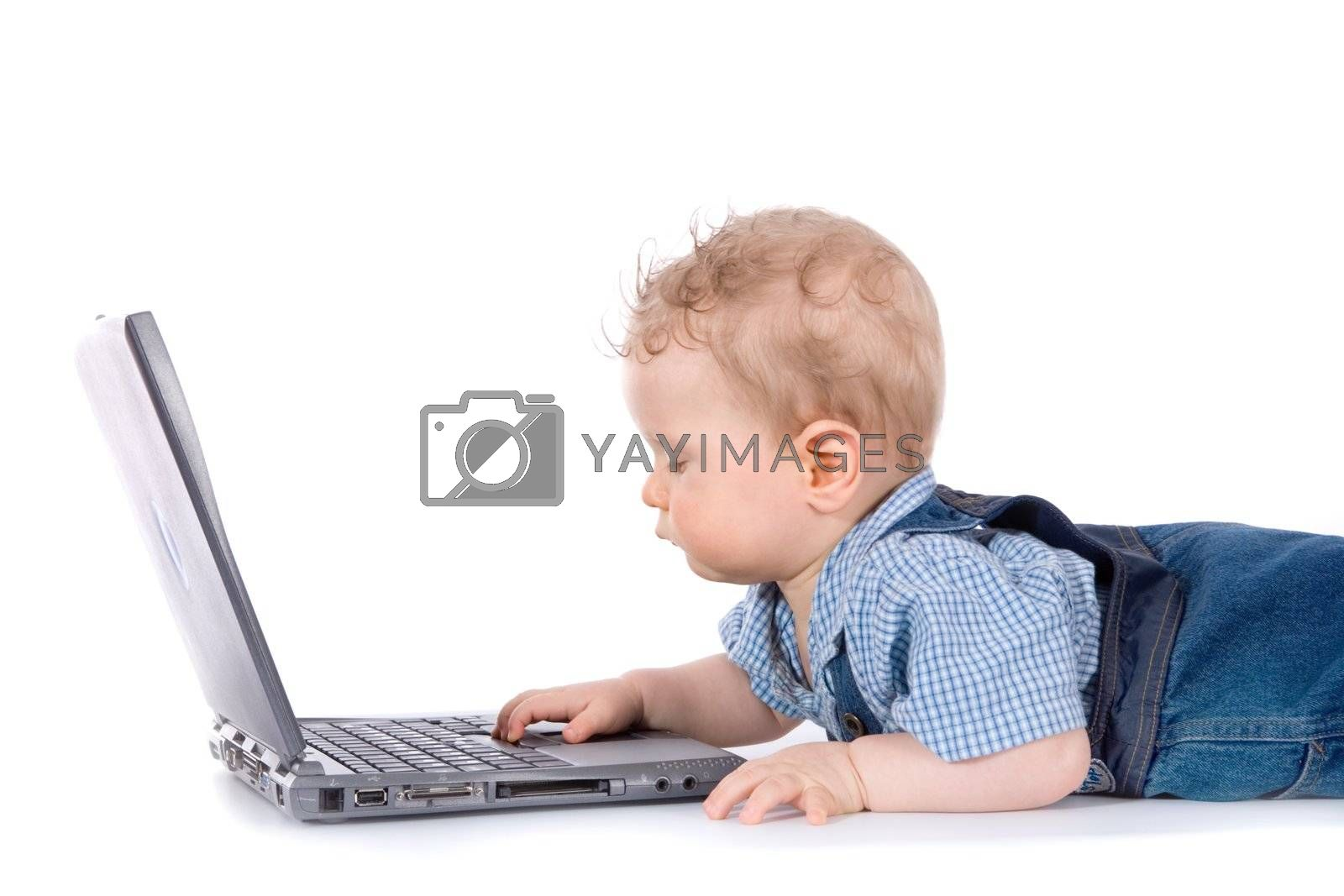 baby with laptop on white