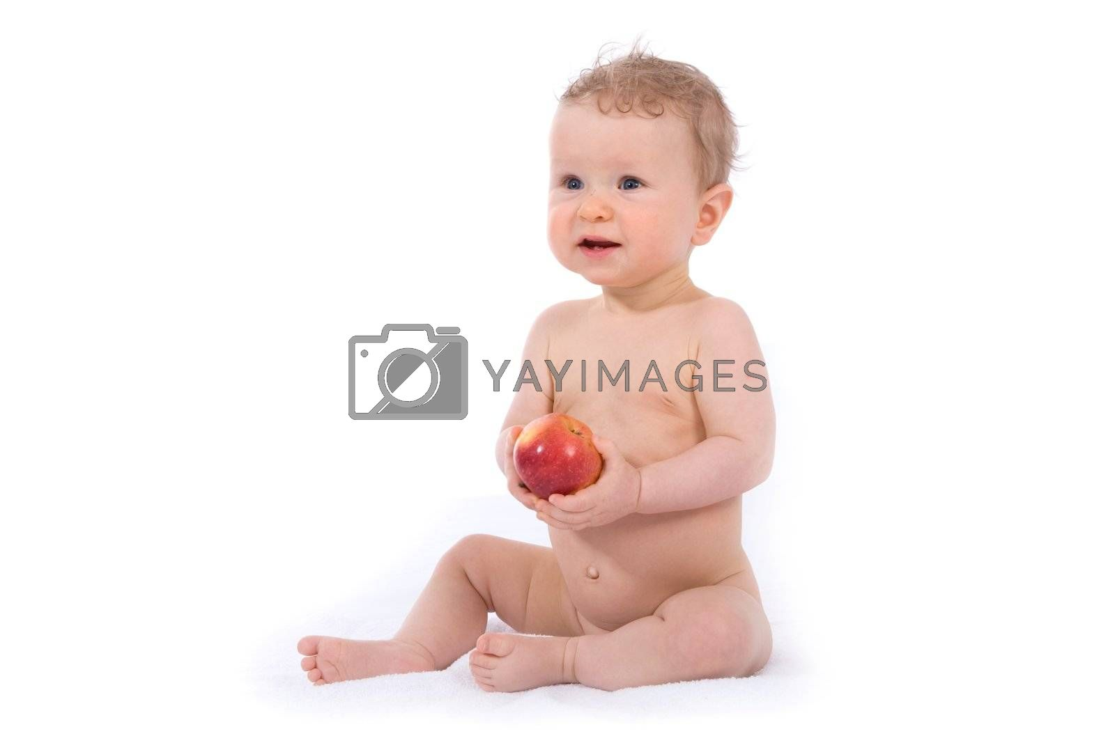 baby with apple on white