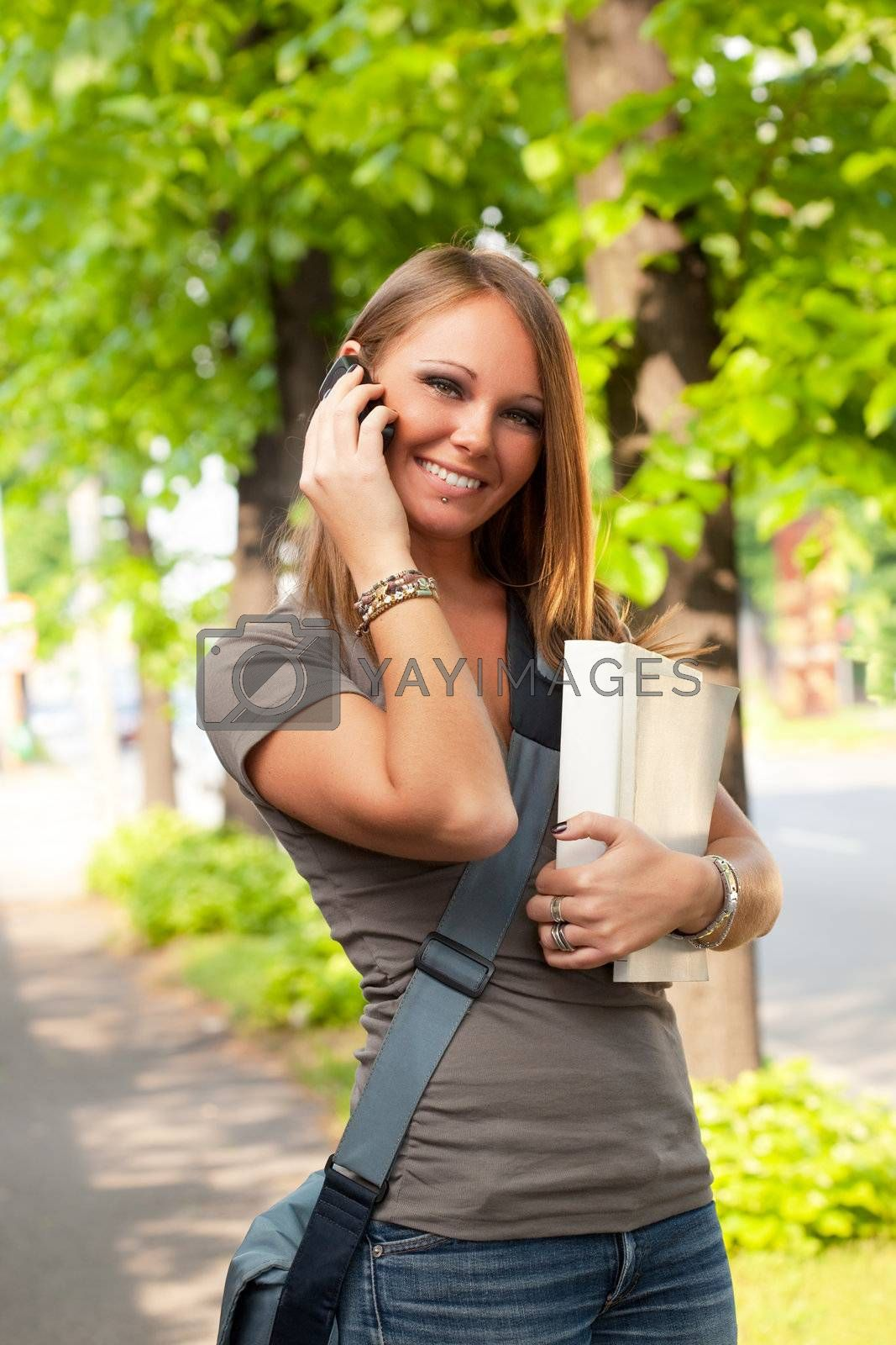 female college student talking on the phone outdoors