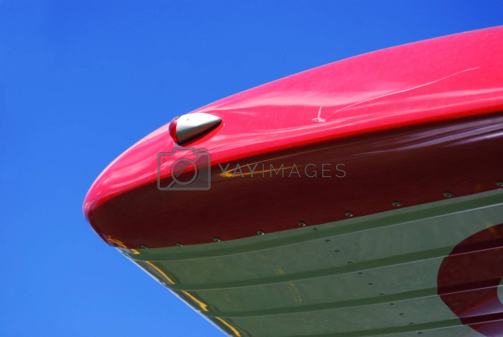Airplane detail with reflections by windmill