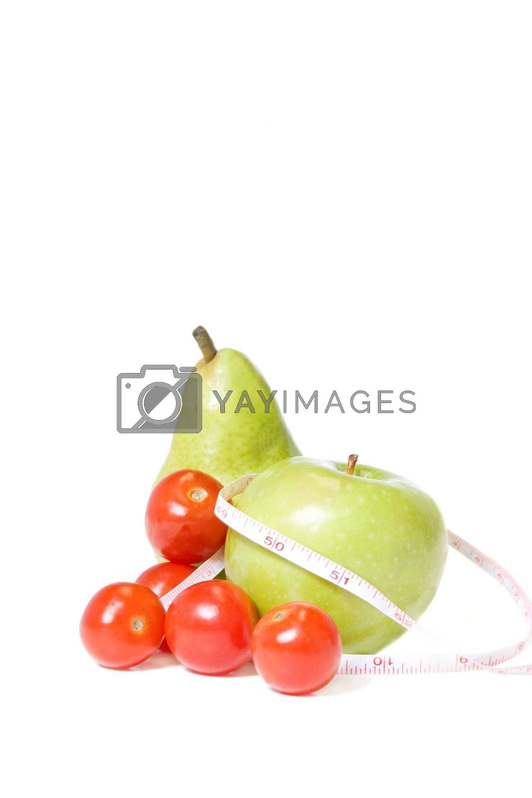 isolated fruit and tomatoes with a measuring tape