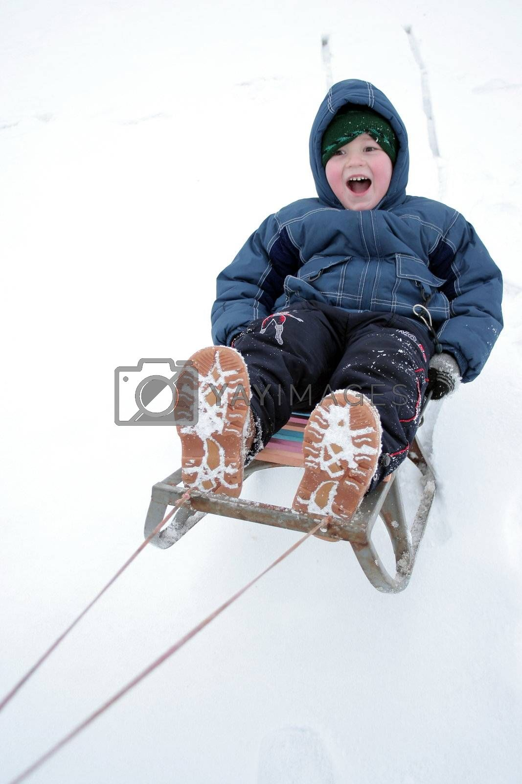 Winter riding of the boy on sled 2