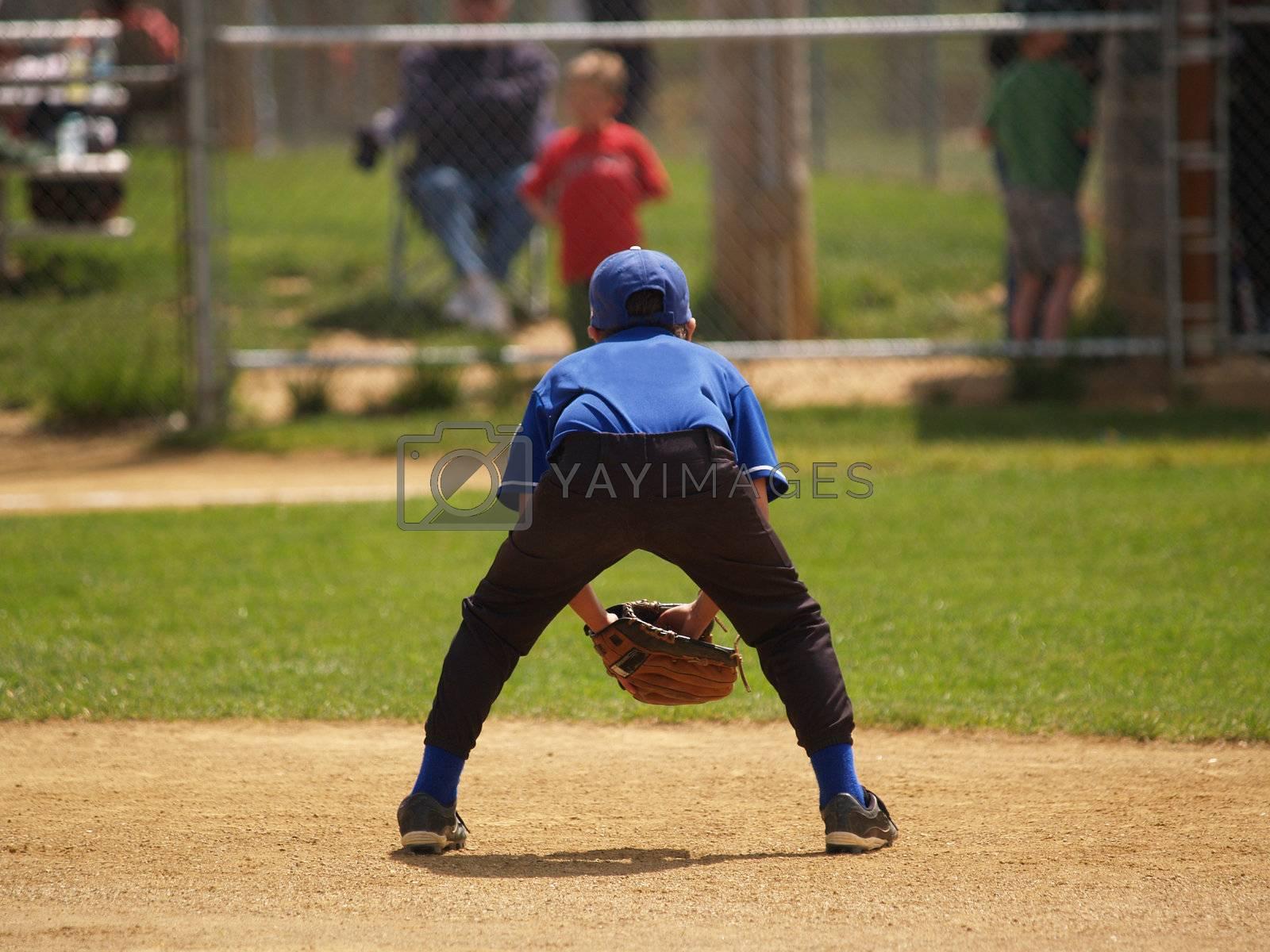 back view of a little league baseball player