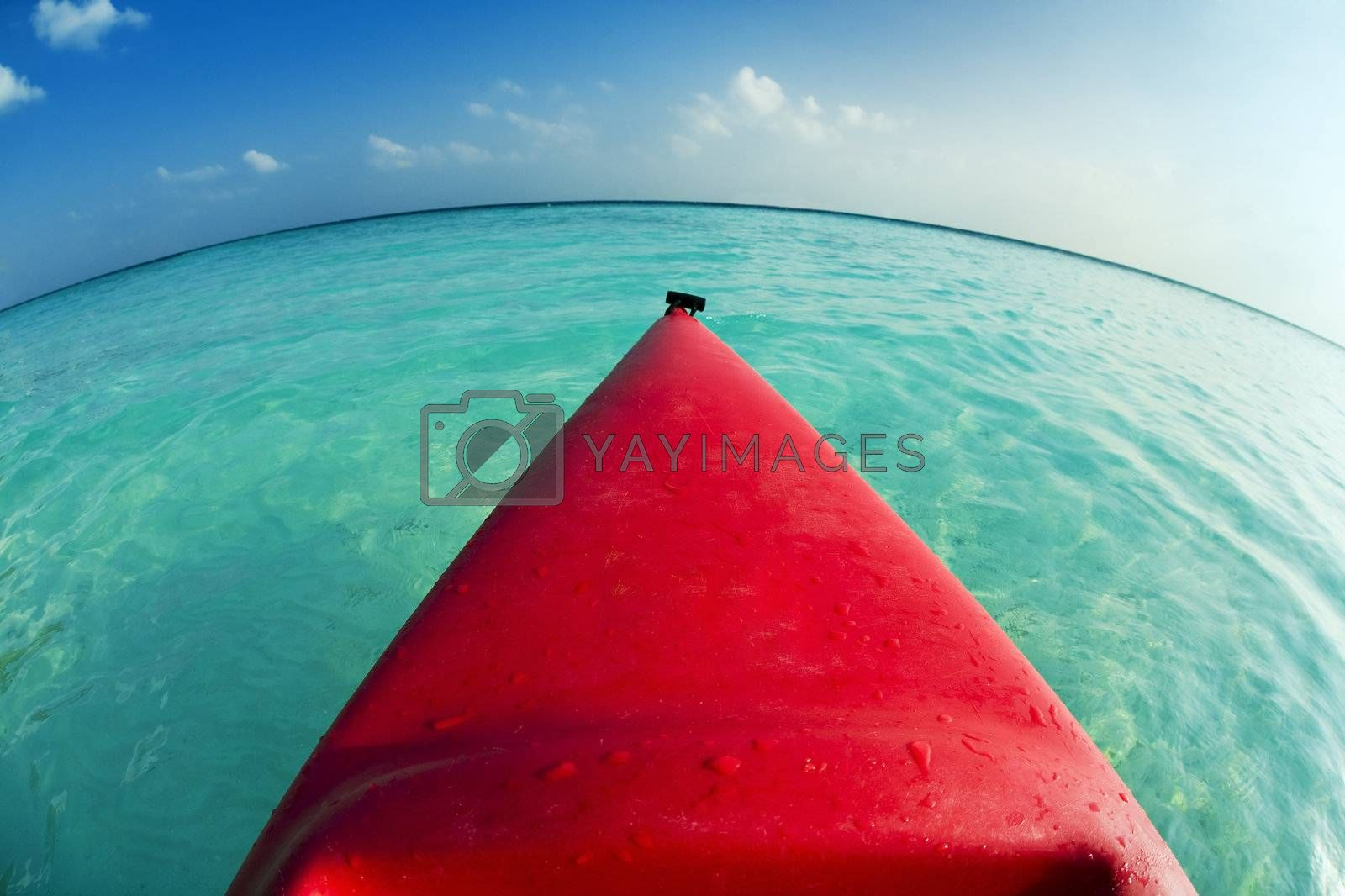 tropical beach: red canoa on the seashore