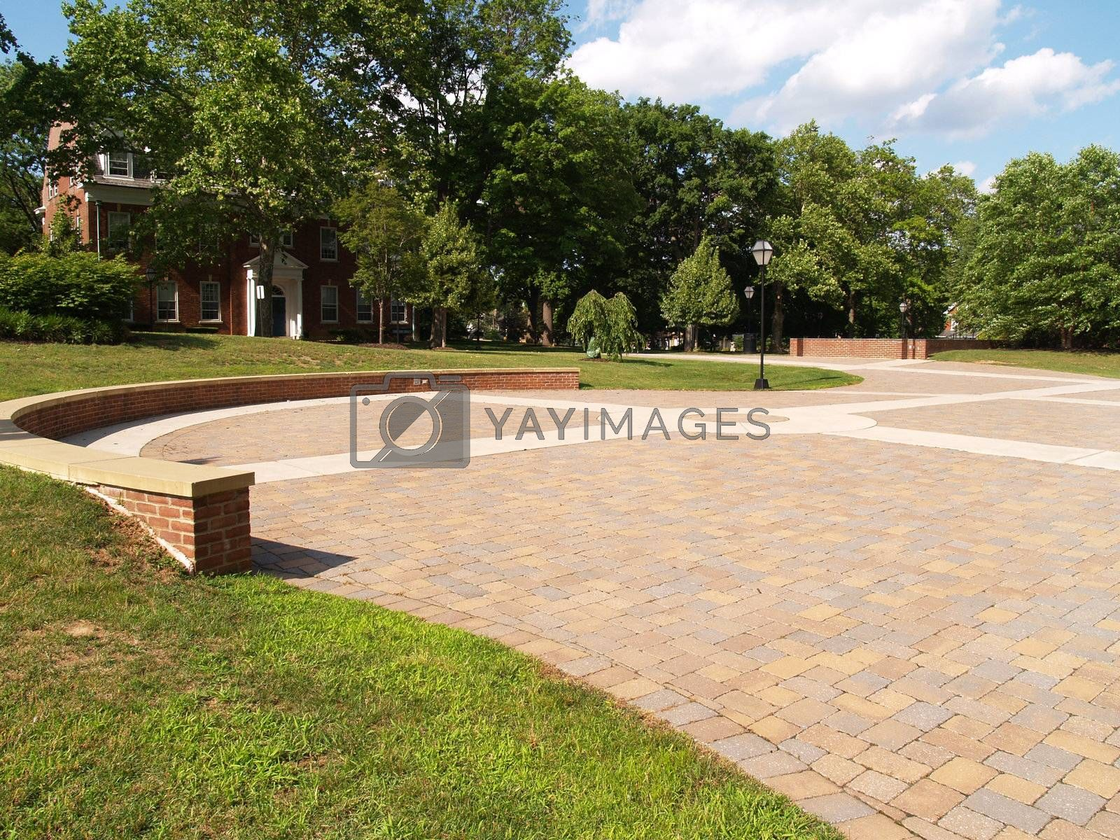 a large brick outdoor patio area on a college campus