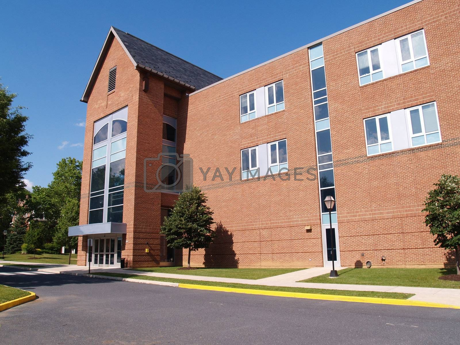 exterior of a modern brick building on a college campus