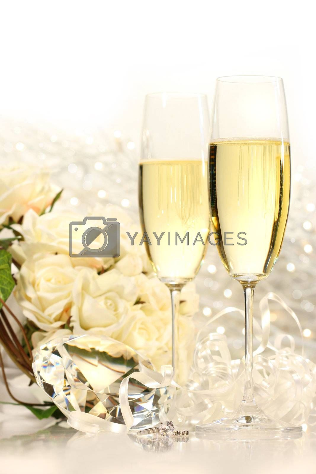 Champagne glasses ready for wedding festivities by Sandralise