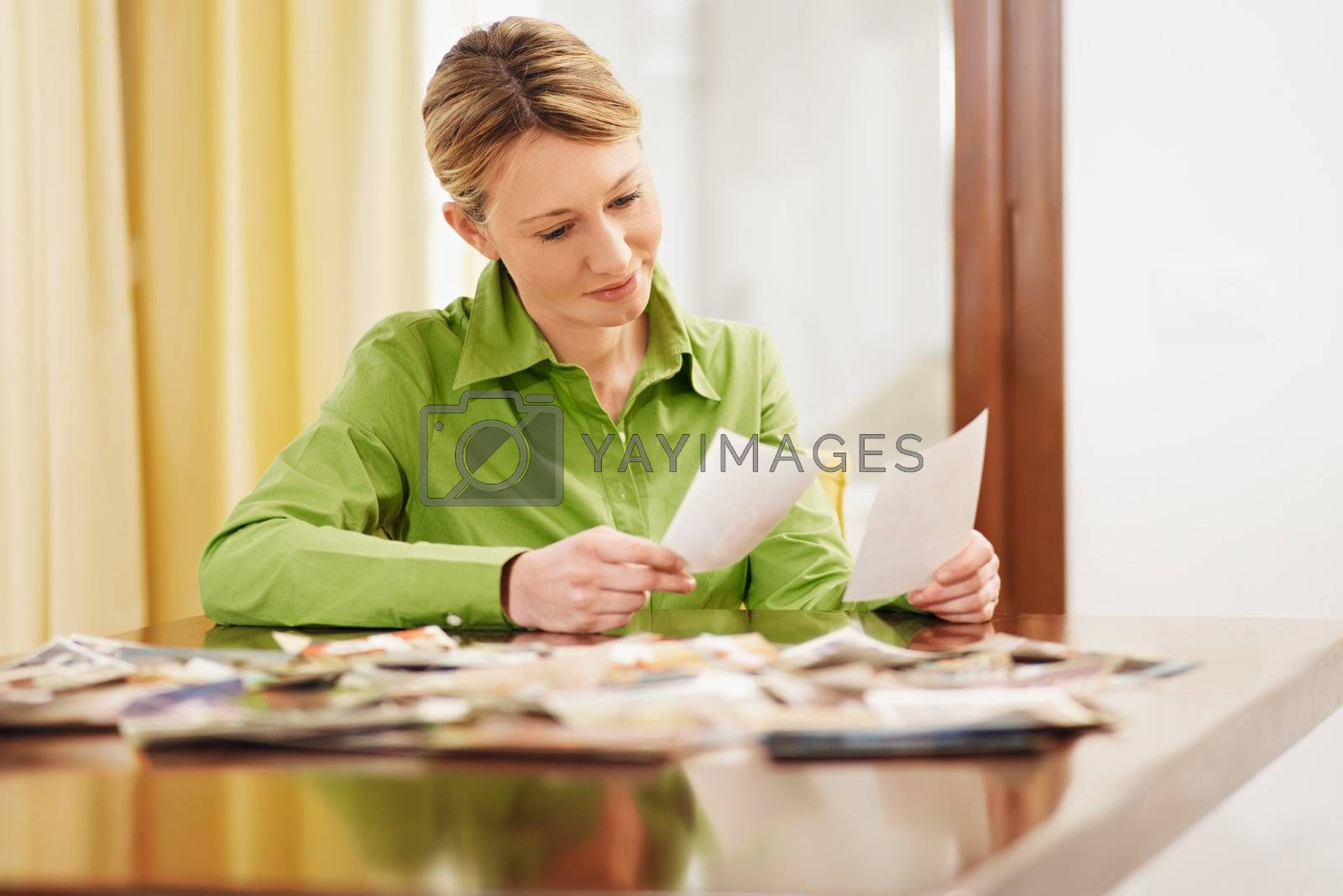 woman sitting and looking at pictures
