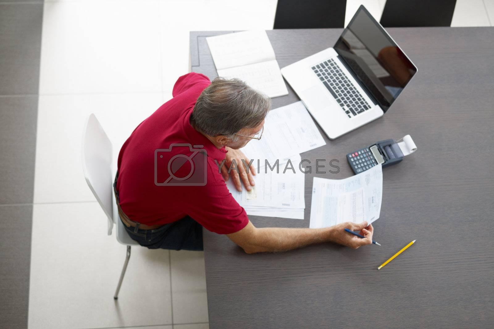 Senior man checking home finances. High angle view