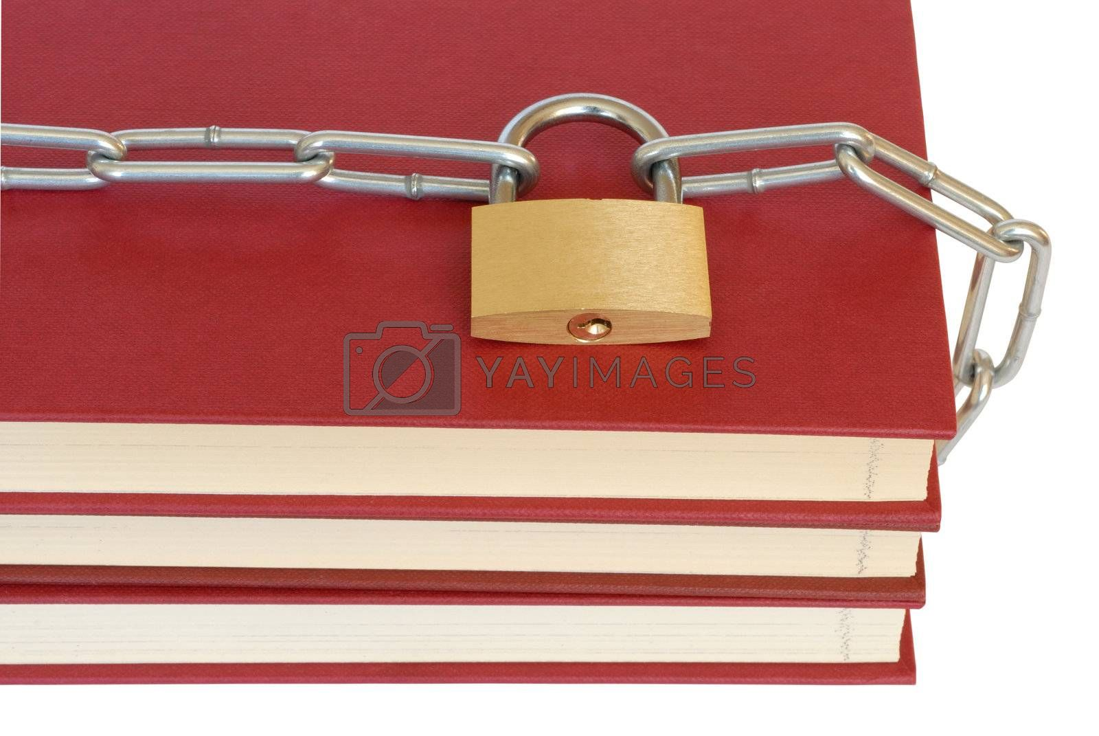 Close-up of books, chain and padlock