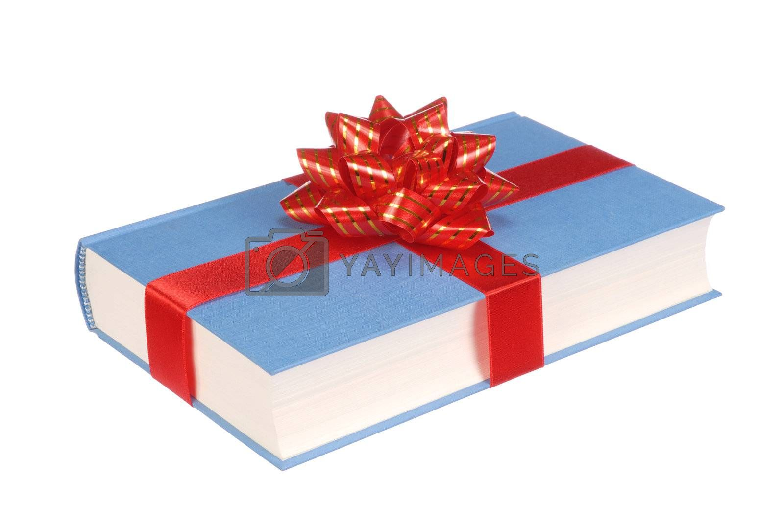 Book with ribbon and bow isolated on white