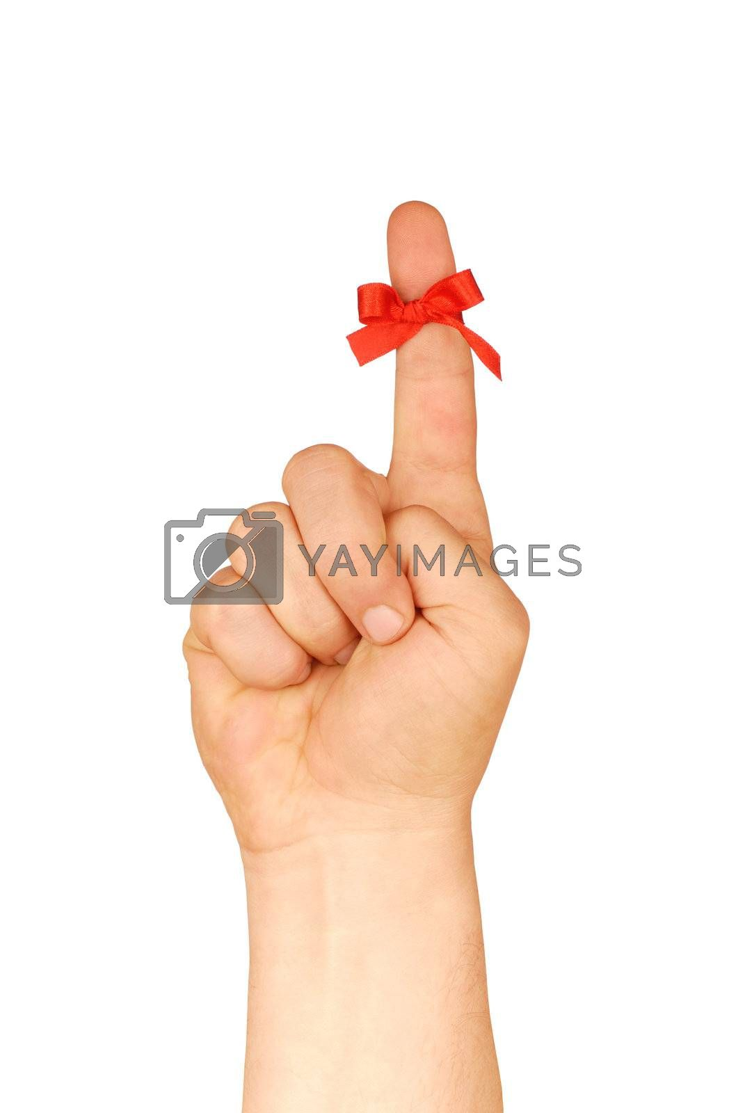 Hand with red ribbon bow isolated on white