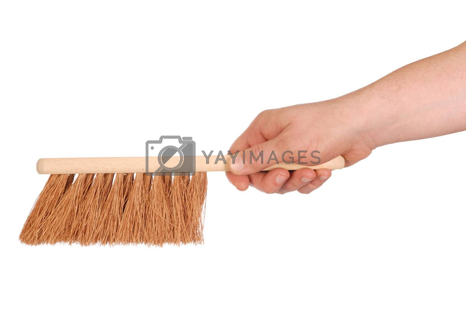 Hand holding a brush isolated on white