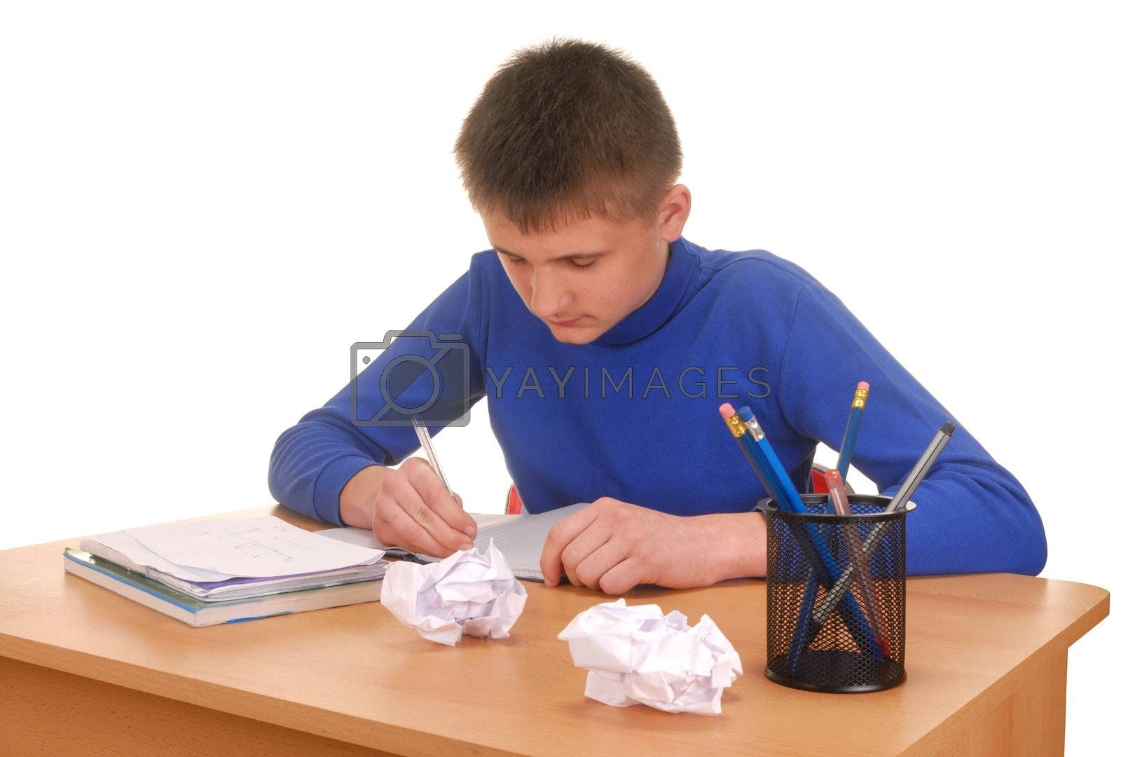 Teenager doing his homework at a desk