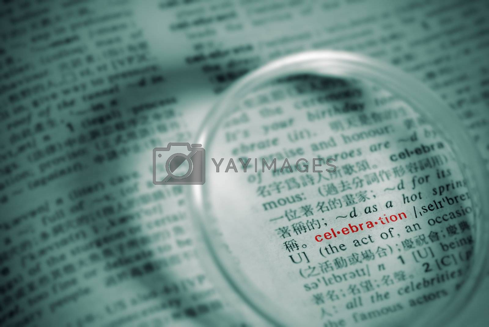 Focus on celebration of book with magnifier in green.