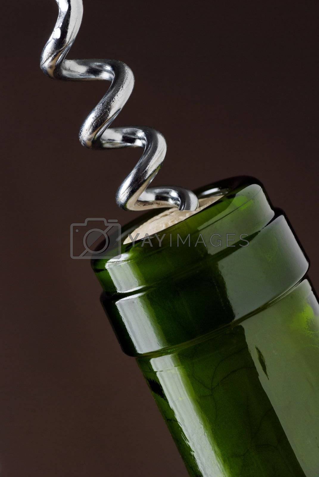 macro close up of corkscrew in wine bottle cork