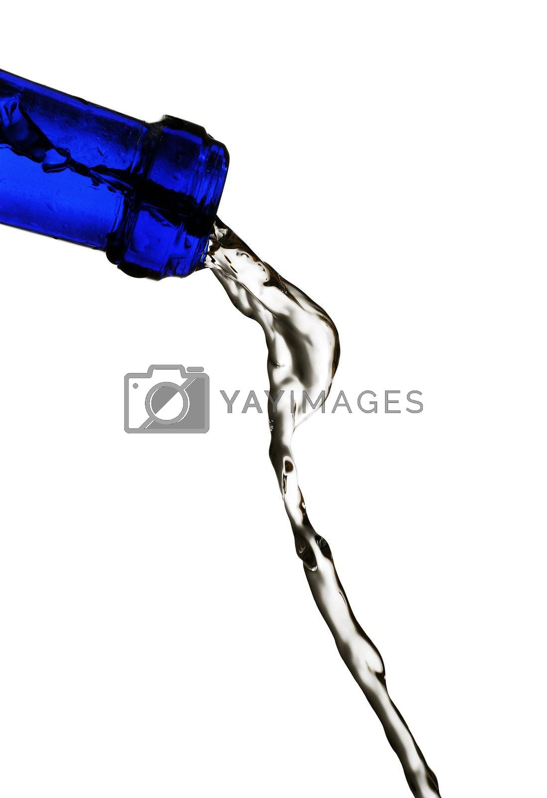 water being poured from a blue glass bottle