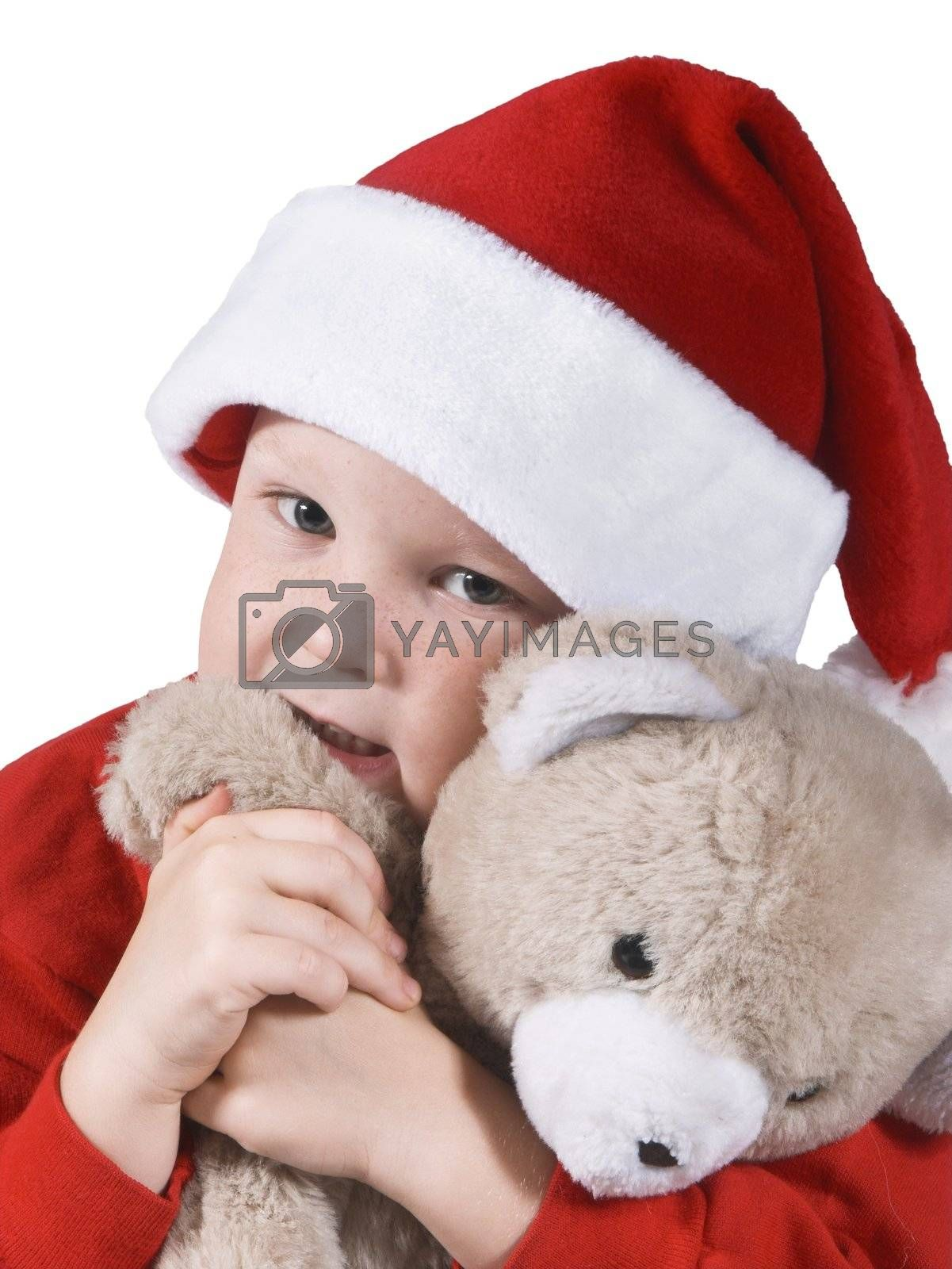 isolated child in a santa hat and stuffed bear