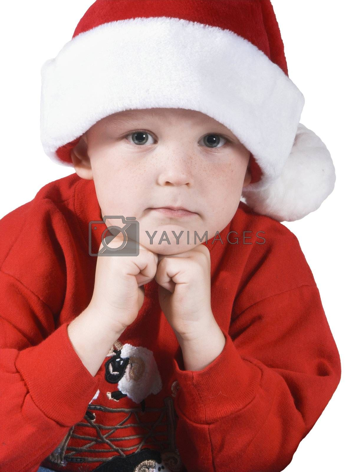 isolated child on white thinking or wishing with santa hat
