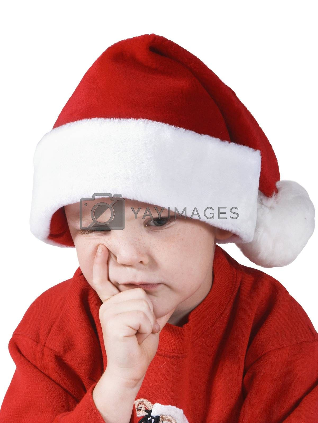isolated child thinking or wishing with a santa hat