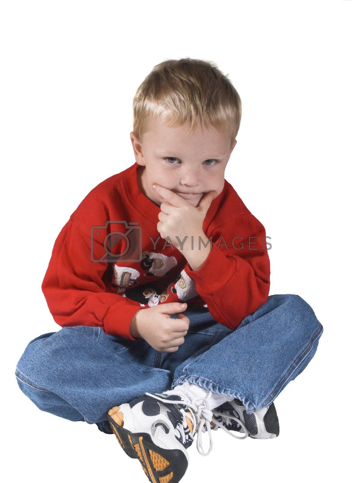 isolated boy sitting and thinking