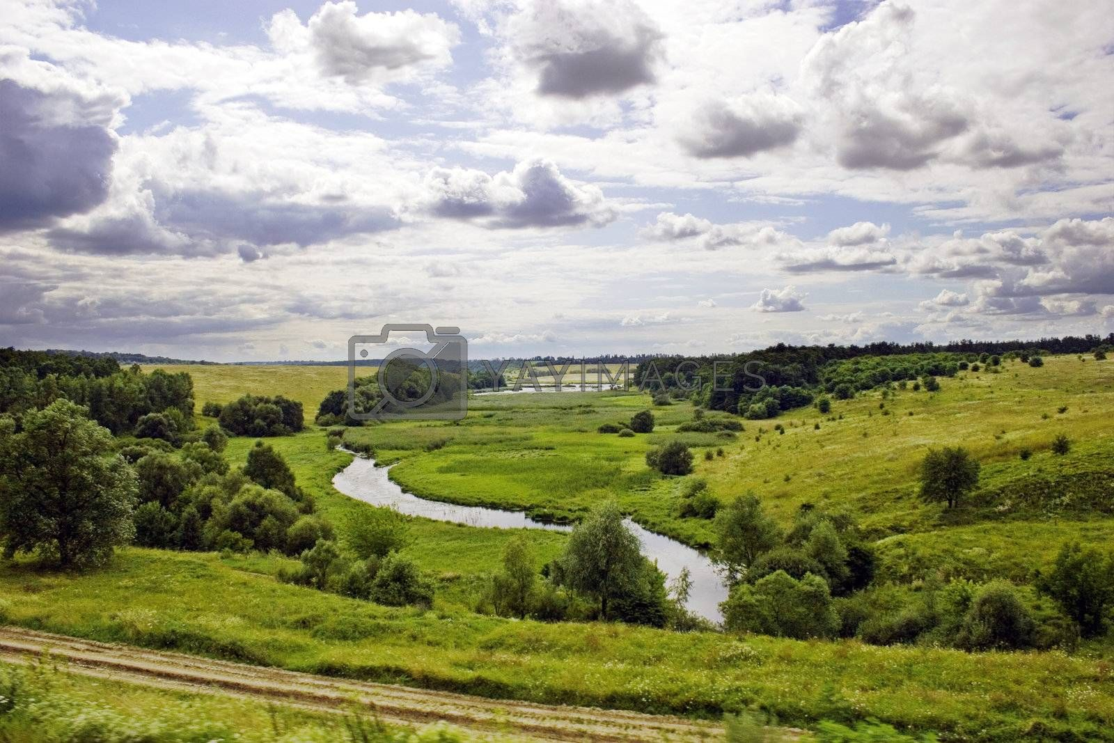 River and meadows with trees and blue sky with clouds. Summer's landscape. Russia.