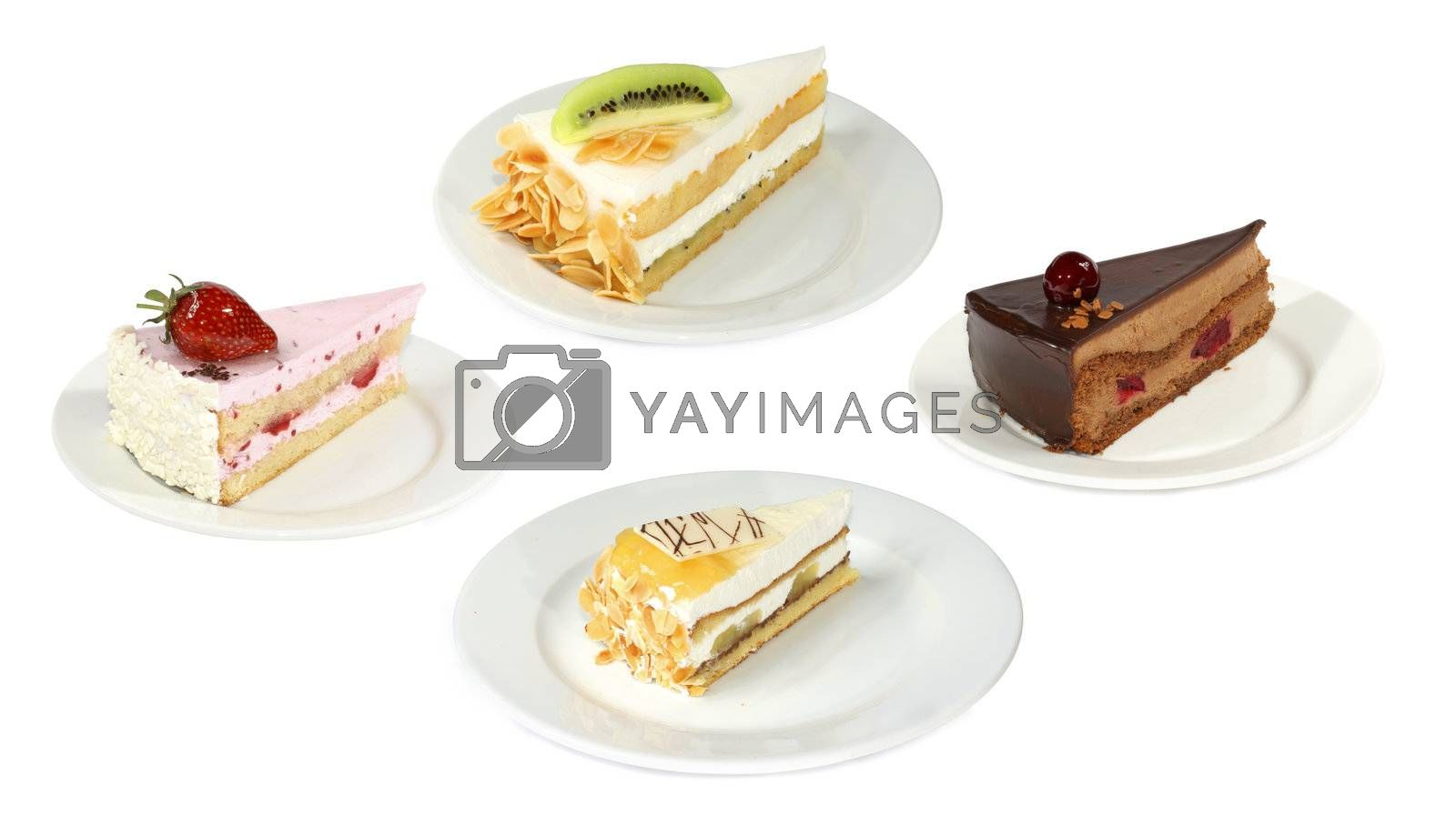 Four plates with sweet cakes. It's very tasty.