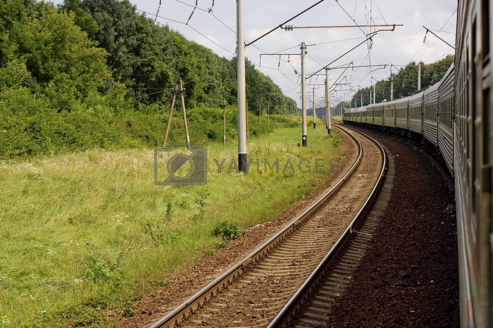 Passenger train in low motion at summer time. Russia.