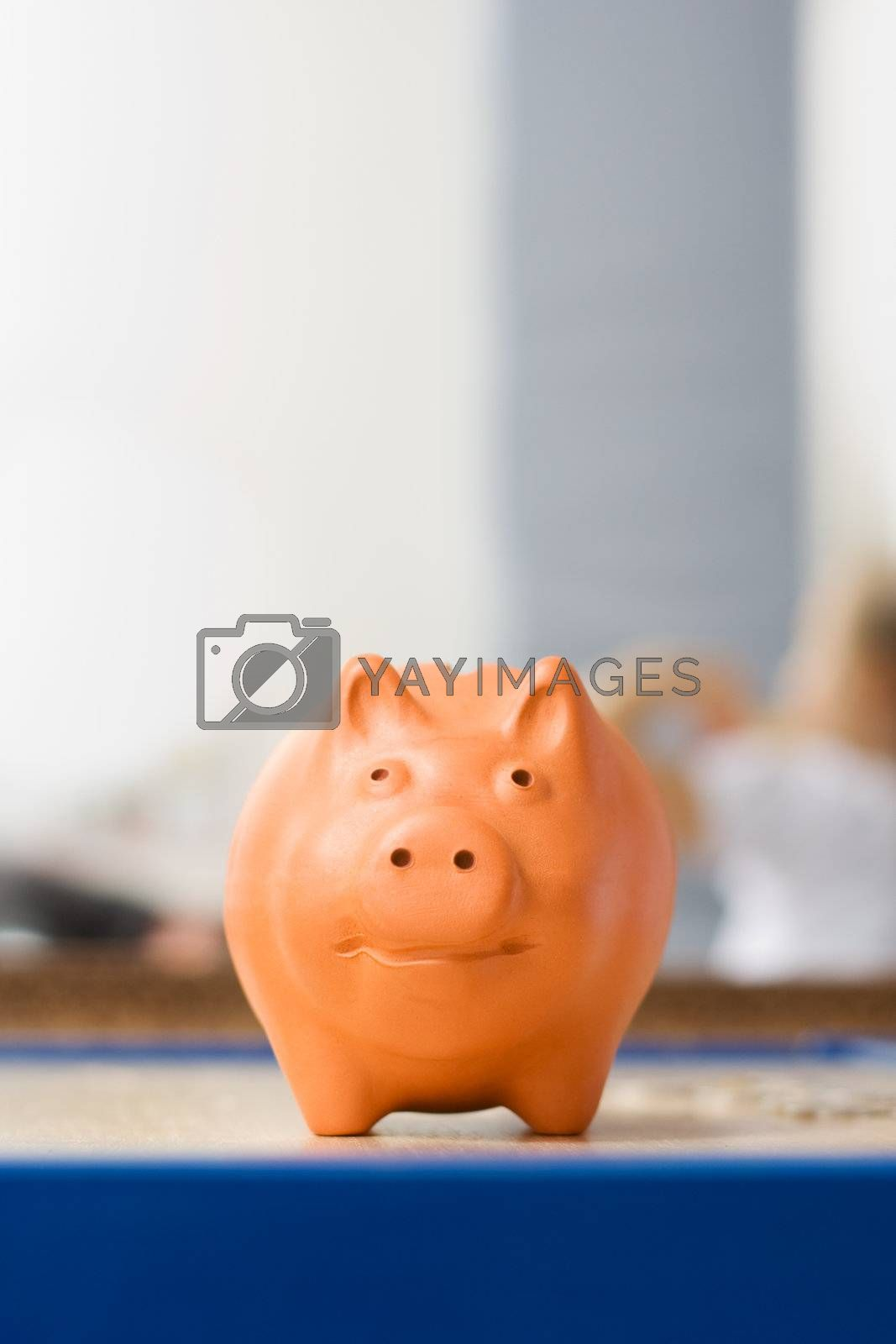 Fat clay piggy bank on the table