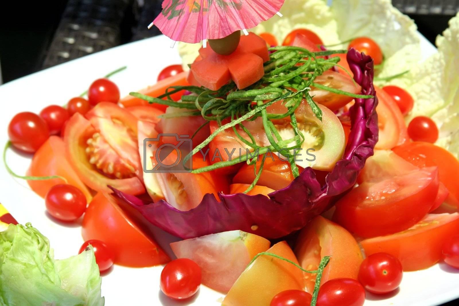 Sliced tomato lettuce salad fresh raw vegetables