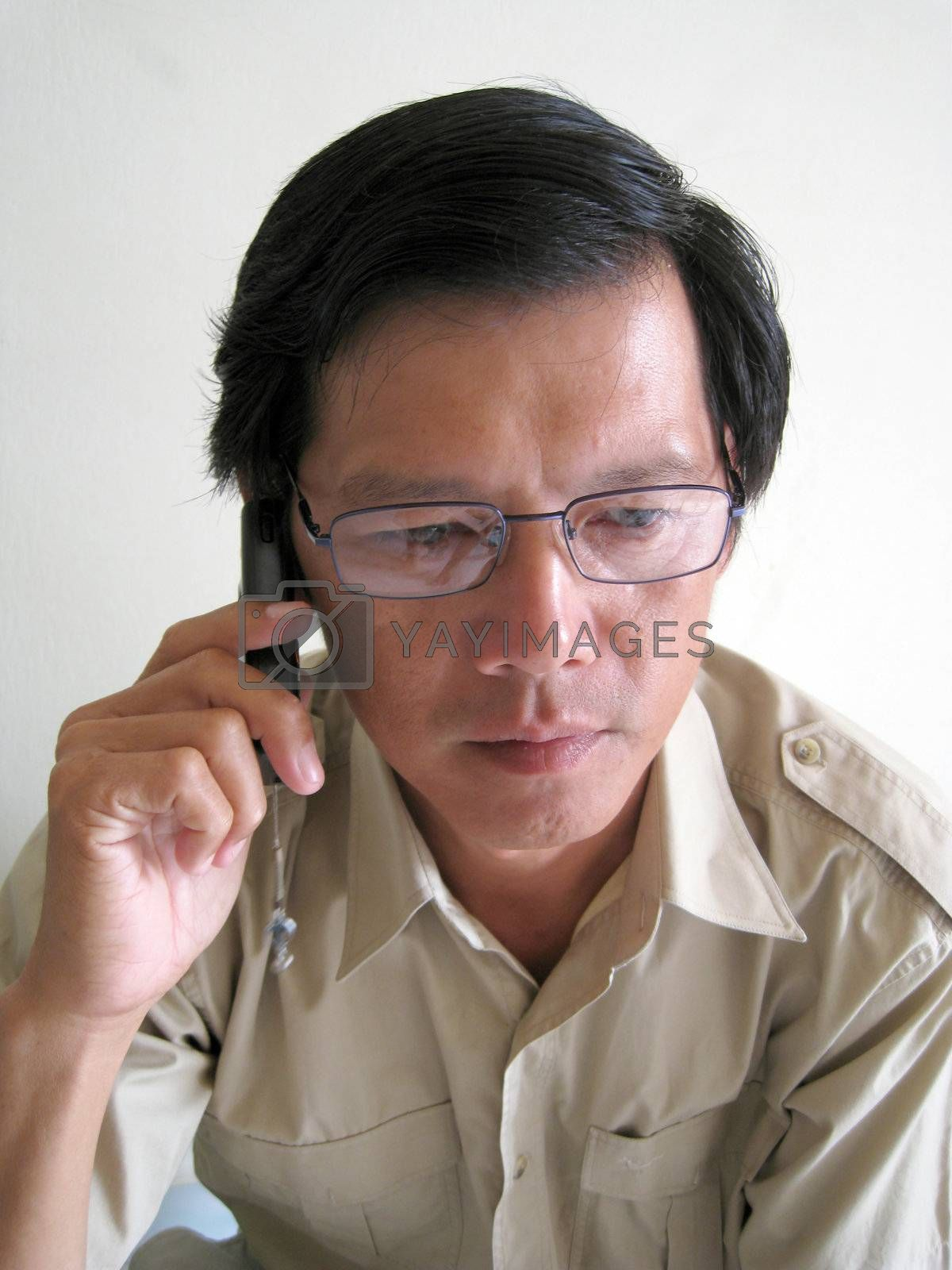 A business Asian man talking on phone
