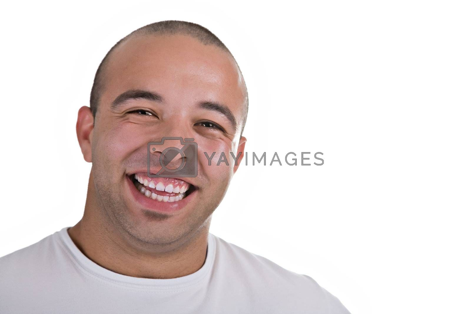 Casual portrait of a young man smiling, over white background.
