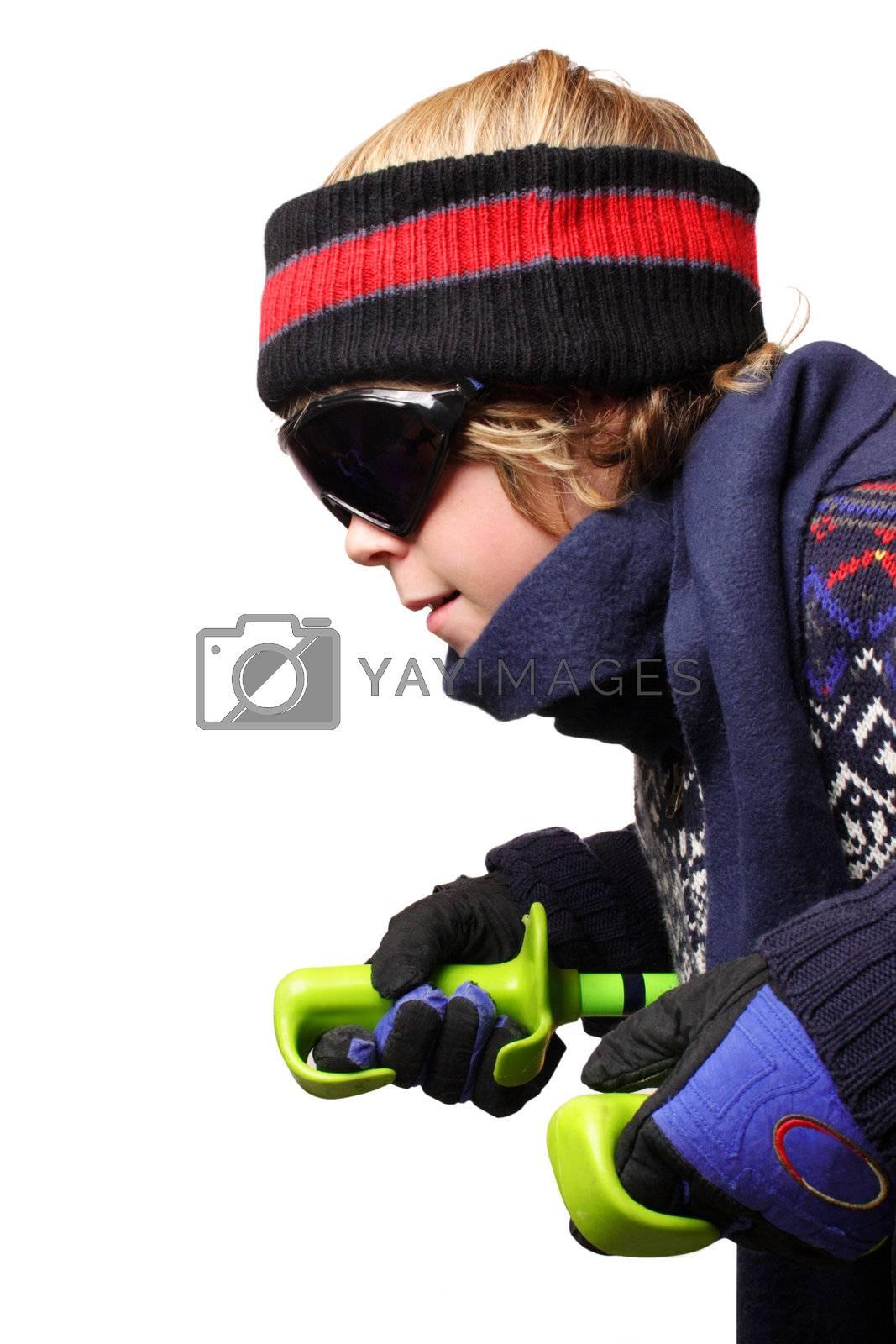 Isolated shot of a boy crouching holding ski poles