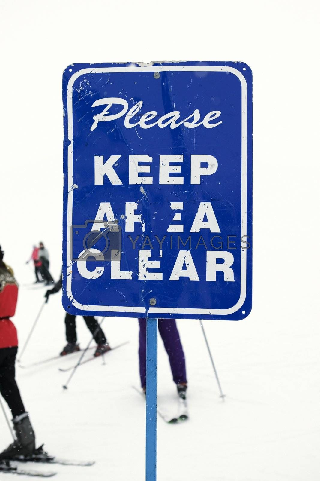 Sign at ski slope requesting area be kept clear.