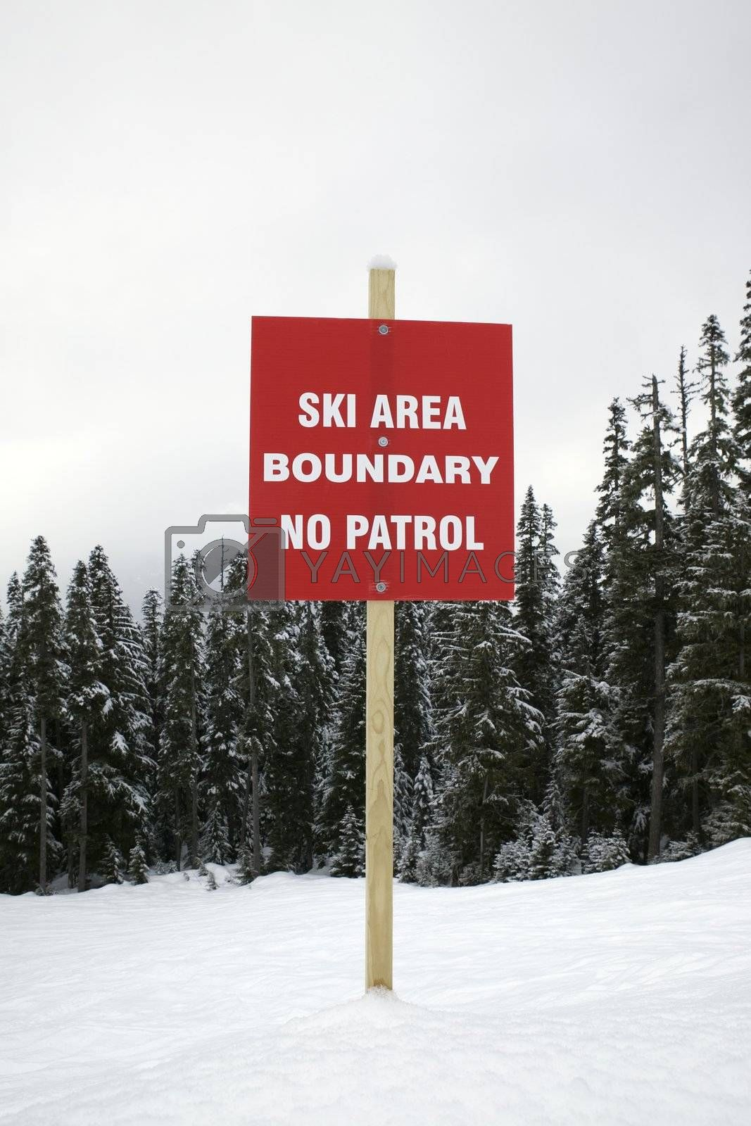 Boundary sign at ski slope warning of no patrol.