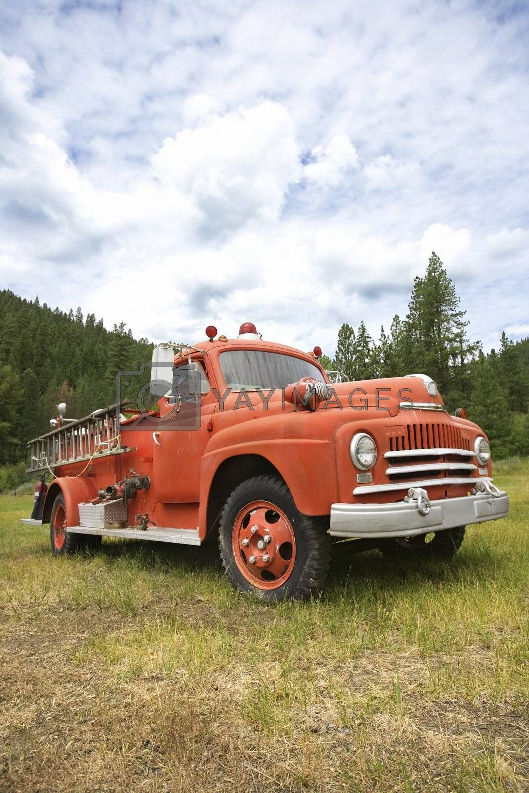 Low angle view of old fire truck in field.