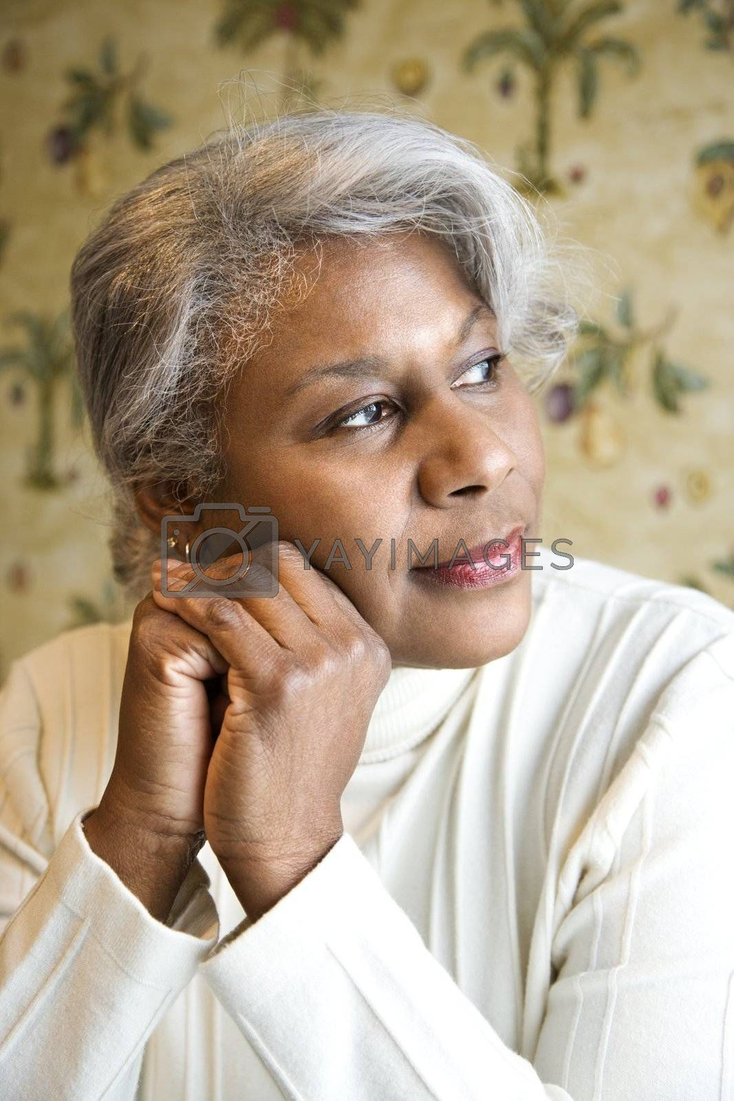 Portrait of mature African American woman looking to the side.