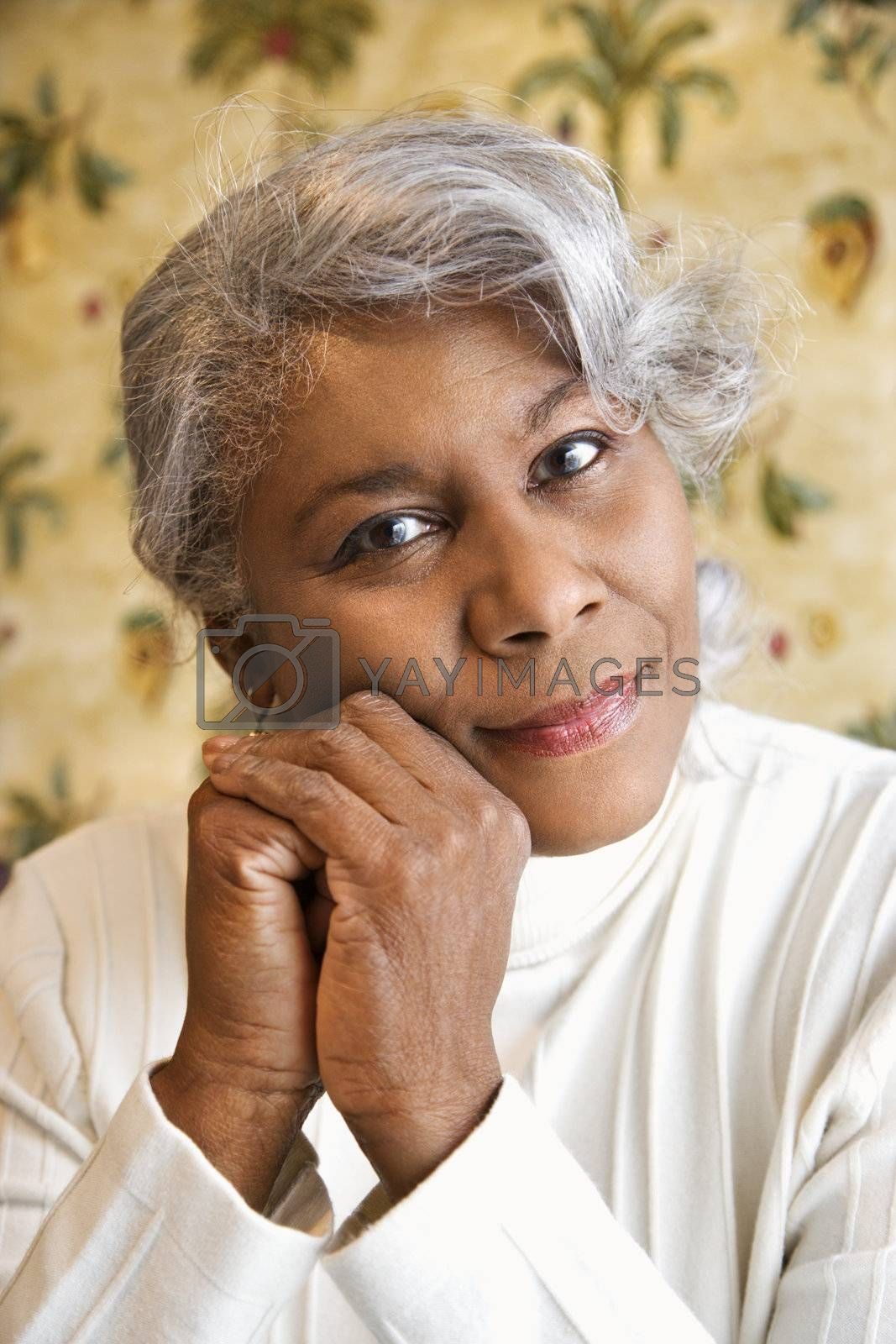 Portrait of mature African American woman looking at viewer.